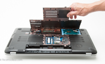 Gently pull the bottom cover to expose the drive bay of the HP Envy 17